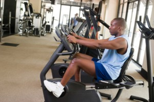 Man Exercising On Stationary Cycle