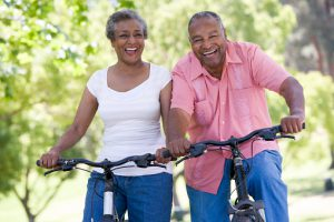 Older couple on bike ride in park