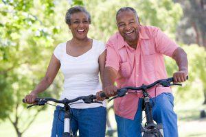Older couple on bike ride in park