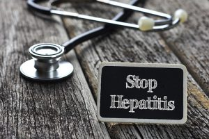 Medical Concept- Stop Hepatitis word written on blackboard with